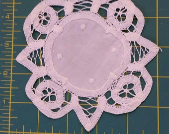White Battenburg lace doily.