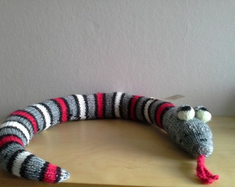 Grey, white, black and red striped snake.