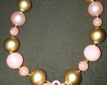 Pink and gold necklace with heart pendant