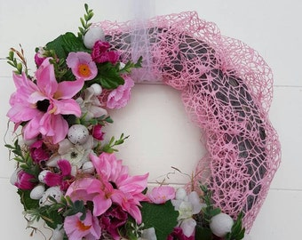 Easter Spring wreath with flowers. With white accents and small eggs.