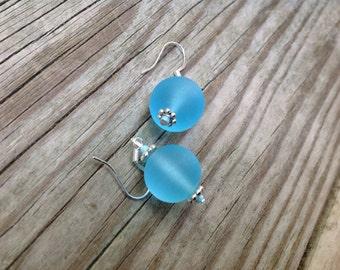 Blue glass bead earrings.