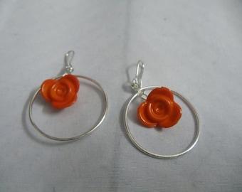 Orange flower hoop earrings