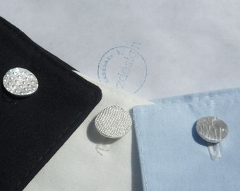 Silver cufflinks with organic structures, cuttlefish, sea urchins, grid