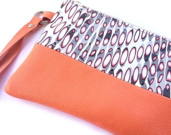 Wristlet pouch in orange leather and printed satin. Makeup case. Toiletry bag for women. Orange leather Travel pouch.