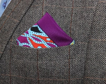 This one of a kind handkerchief is the one which does the job, purple pocket square