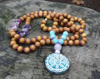 how to use mala beads to meditate