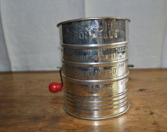 Vintage Metal FLOUR SIFTER with RED Wooden Handle. Made by Bromwells. Very Clean. Measurement Marking on Outside.