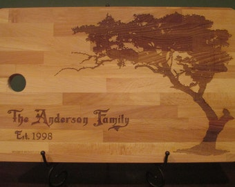 Great wedding or Anniversary gift.  Large personalized beech cutting board with family name, est date and tree design.