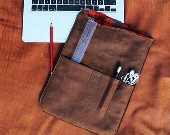 Genuine padded leather laptop sleeve.