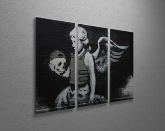 "Banksy Body Armor Angel Gallery Wrapped Canvas Triptych Print 48"" x 30"""
