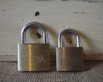 Pair of gold Tesla padlocks with keys