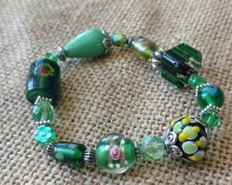 Green lamp work bead bracelet