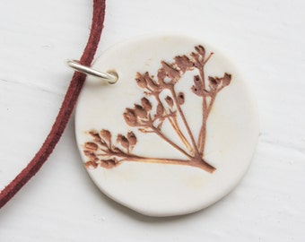 Circular porcelain seedhead pendant