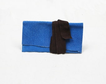 Sleeve for iPod Touch in deep turquoise suede, closes with brown suede hand cut wraparound tie