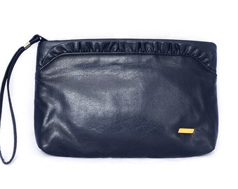 Navy leather clutch with wrist strap