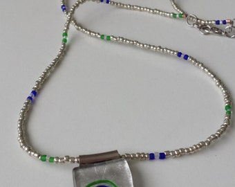 Unusual blue green focal with single seed bead chain