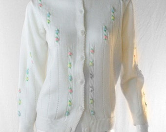 cutesy white button up sweater with knit flower detail
