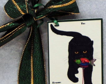 Black Cat Carrying Fish Ornament -- Gift Tag in Christmas Colors