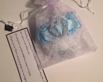 Something blue garter and lucky sixpence