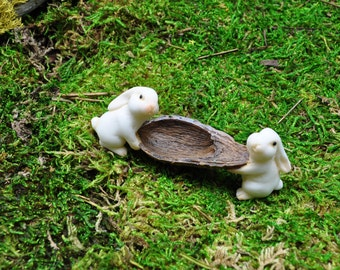 Two Rabbits Carrying Nut Shell