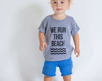 Toddler tee. Kid shirt. Funny tee. We Run this Beach