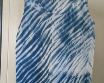 "Sleeveless tee with ""Arashi"" Shibori design hand-dyed in indigo."