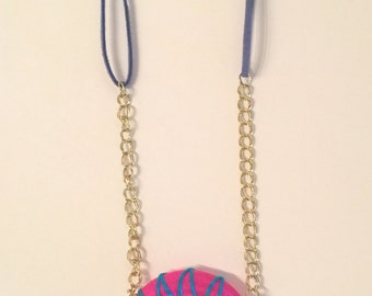 Funky pendant necklace with blue and pink accents