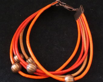 5 Strand Leather Bracelet in Red and Orange with Antique Copper Pumpkin Beads
