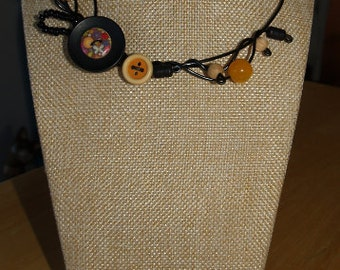 Simply yellow necklace, black wire, button