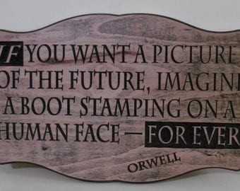 carved George Orwell quote sign