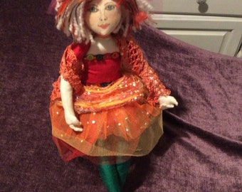 Vibrant funky cloth art doll