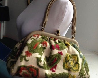 Vintage carpet bag with colorful brocade.