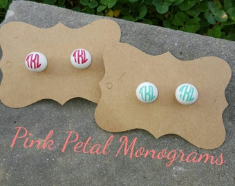 Monogramed white stud earrings