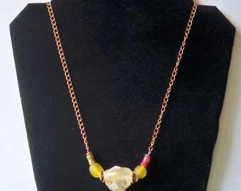 Rock center necklace with yellow and pink beads