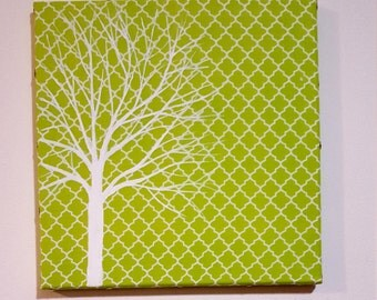 Hand painted tree over green fabric