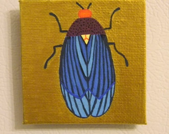 Blue Insect with Gold Metallic Background