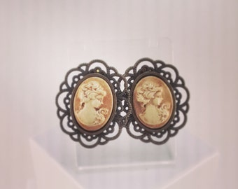 Framed bronze lobe earrings and hand painted ceramic cameo