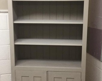 Tall bookcase with cupboard