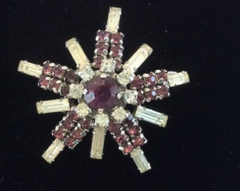 Signed Jay Flex violet and clear crystal star brooch, 1950s era