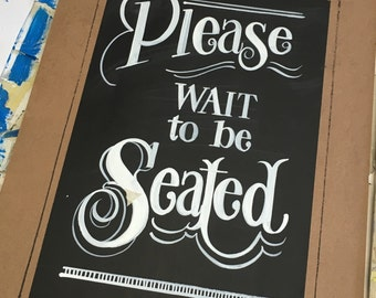 Please be seated sign
