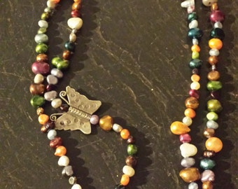 Multistrand dyed multicolored pearl necklace with Thai silver butterfly