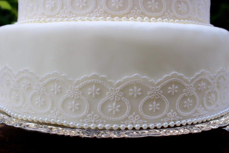 Vintage Ivory Lace & Pearl Wedding Cake by PolkawolfandMagpie