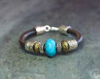 Leather, turquoise stone bracelet.