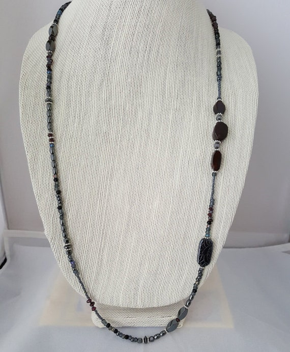 Fancy long hematite and garnet necklace
