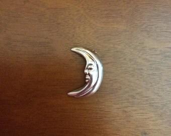 Silver moon face brooch