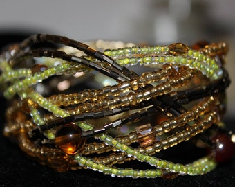 Plaited Crystals and beaded bracelet Brown and yellow