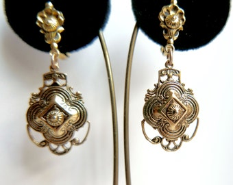 Victorian revival earrings.  Clip-on. Gold with black detailing.