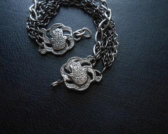 reduced - wanderlust: morrocco ii - filigree hamsa morrocan souvenir silver and gunmetal apotropaic charm bracelet