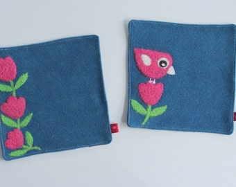 Set of two blue wool fabric coasters with needle felted fuchsia pink flowers and birdie bird