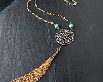 Long Golden Tassel Necklace: Sterling silver shield, goldfilled chain, vermeil findings, turquoise rondelles, 21 inches long, 6 inch pendant